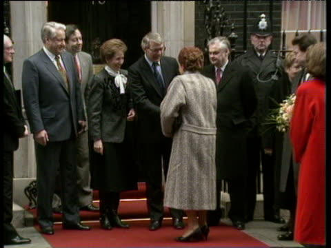 Prime Minister John Major and wife Norma greet President Boris Yeltsin's wife Naina and all stand for photocall outside 10 Downing Street London 30...