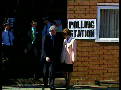 Prime Minister John Major with wife Norma and son James posing for photographers at polling station in Huntingdon 1997 General Election 01 May 97