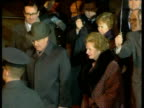 Prime Minister Margaret Thatcher and President Mikhail Gorbachev walk though rain chatting and smiling at Heathrow Airport Gorbachev's wife Raisa in...