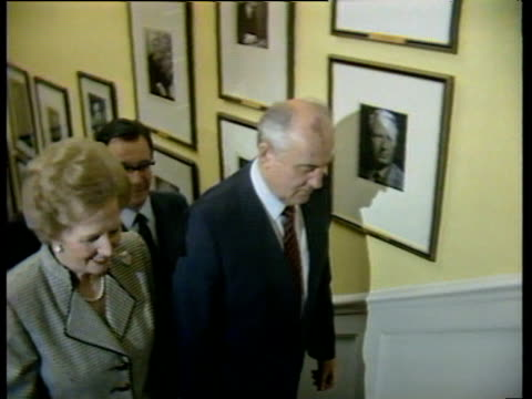 Prime Minister Margaret Thatcher and President Mikhail Gorbachev walk up stairs inside 10 Downing Street London 06 Apr 89