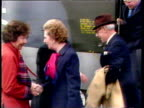 Prime Minister Margaret Thatcher disembarks Hercules at Stanley airfield and shakes hands with Civil Commissioner Rex Hunt and senior army officers...