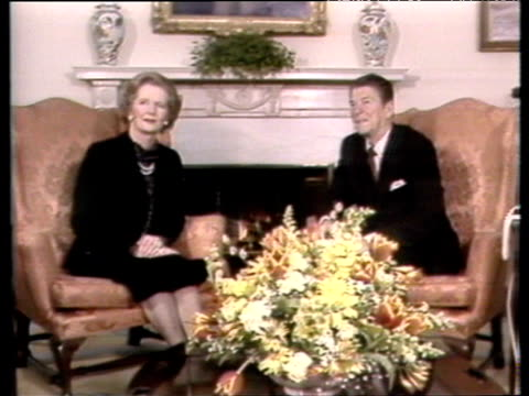 Prime Minister Margaret Thatcher sits with President Ronald Reagan in front of fire in White House drawing room Washington DC 26 Feb 81