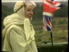 Prime Minister Margaret Thatcher sitting in Challenger tank with Union Flag fluttering alongside whilst on visit to see military manoeuvres at...
