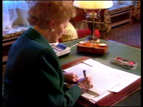 Prime Minister Margaret Thatcher working at large desk in 10 Downing Street London 1990's