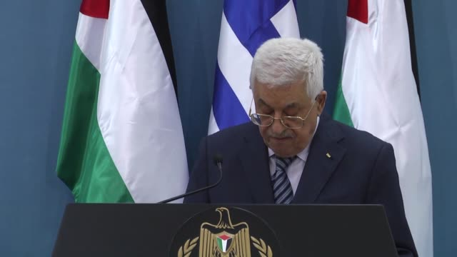 Prime Minister of Greece Alexis Tsipras and Palestinian President Mahmoud Abbas attend a joint press conference after their meeting in Ramallah West...