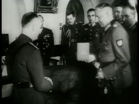 ROMANIA Prime Minister of Romania Ion Antonescu standing in room talking w/ German officers German Nazi General field Marshall Eric von Monstein...