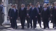 Prime Minister of Turkey Ahmet Davutoglu inspects the site of Ankara bomb attack alongside Turkish Interior Minister Efkan Ala and leaves carnations...