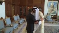 Prime Minister of Turkey Ahmet Davutoglu meets with Emir of Qatar Sheikh Tamim bin Hamad Al Thani during his visit in Doha Qatar on April 28 2016