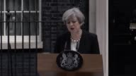 Prime Minister Theresa May addresses the media in Downing Street London after a suicide bomber killed 22 people including children as an explosion...