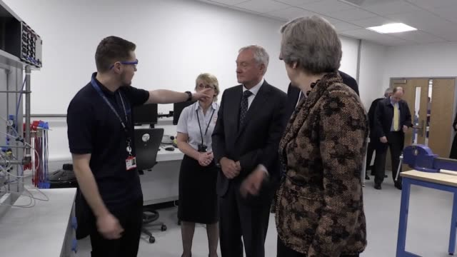 Prime Minister Theresa May and Chancellor Philip Hammond tour an engineering training facility and meet with staff and apprentices Theresa May...