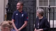 Prime Minister Theresa May watches Stuart Broad and Heather Knight take part in the first ever game of cricket to be played in Downing Street It was...