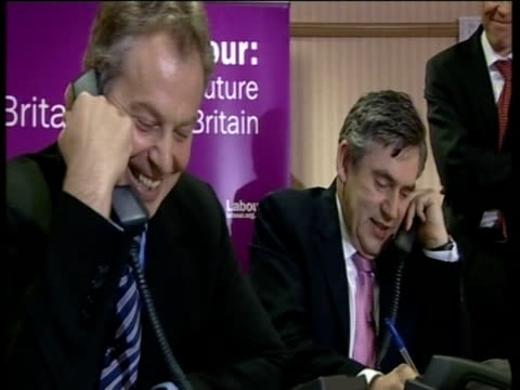 Prime Minister Tony Blair and Gordon Brown making phone calls together at Labour campaign office