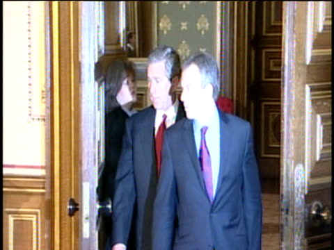 Prime Minister Tony Blair and President George W Bush make way to podium for packed press conference during President Bush's visit to UK Downing...