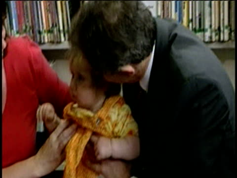 Prime Minister Tony Blair picks up and kisses baby girl in nursery during General Election campaign UK 25 Apr 97