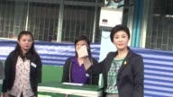 Prime Minister Yingluck Shinawatra casts her vote as polls open for elections in Thailand a day after a gunfight between rival protesters in Bangkok...