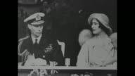 Prince Albert Duke of York and Elizabeth Duchess of York at open door of airplane / the Duke in naval uniform with Elizabeth / she wears an informal...