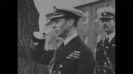 Prince Albert Duke of York in naval Admiralty uniform / simpler naval outfit / peering through a motion picture camera lens / towering bearskin hat...