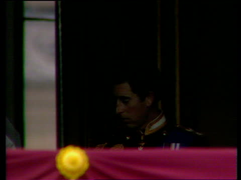 Prince and Princess of Wales emerge from Buckingham Palace onto balcony smiling at crowd Royal Wedding of Prince Charles and Lady Diana Spencer 29...
