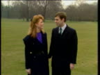 Prince Andrew and Sarah Ferguson holding hands and kissing in grounds of Buckingham Palace for press after announcement of their engagement 19 Mar 86