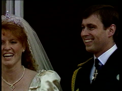 Prince Andrew and Sarah Ferguson on balcony pointing to crowd kissing waving / Queen Elizabeth II arriving / Queen Mother in audience / Prince...