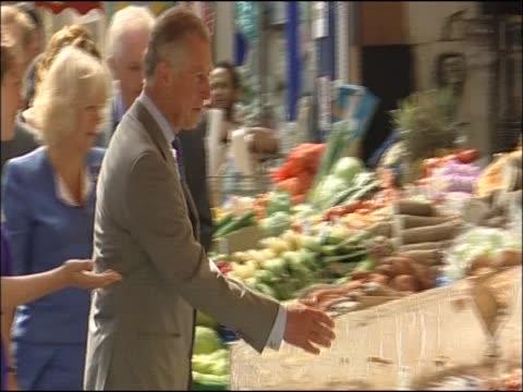 Prince Charles and Camilla Duchess of Cornwall visit Brixton Market