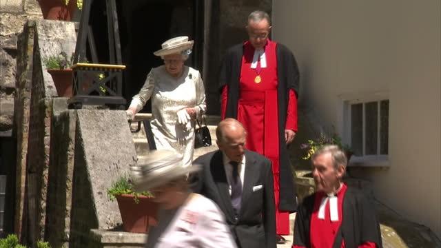Prince Charles and Camilla Duchess of Cornwall walk down steps followed by Queen Elizabeth II talking to clergy Prince Charles Camilla and The Queen...