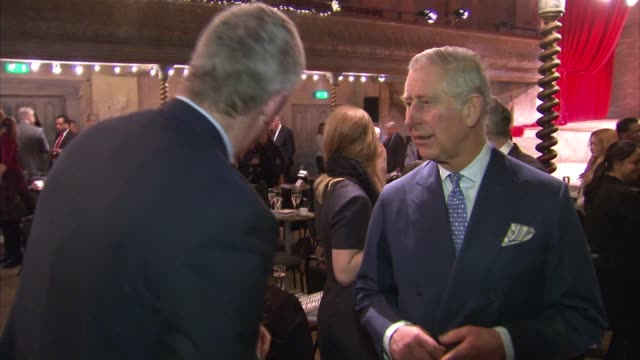 Prince Charles and Camilla visit Wilton's Music Hall More Charles chatting with guests including impressionist Rory Bremner / Camilla chatting with...