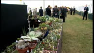 Prince Charles and Duchess of Cornwall at Sandringham Flower Show Charles along / Camilla looking at exhibit / GVs cactus display / Charles and...
