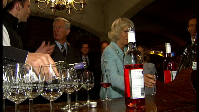 Prince Charles and Duchess of Cornwall visit Denbies Wine Estate Wine being poured into glasses / more of Charles and Camilla tasting wine and...