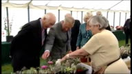 Prince Charles and Duchess of Cornwall visit Sandringham Flower Show Various of Charles and Camilla looking at display of cacti as woman showing...