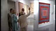 Prince Charles and Duchess of Cornwall visit Welsh Quilt Centre EXT Camilla Duchess of Cornwall talking to public during brief walkabout Charles and...