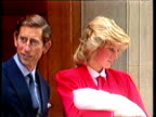 Prince Charles and Princess Diana carrying newborn baby Prince Harry pose for press on steps as they leave St Mary's hospital London 16 Sep 84