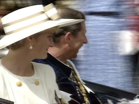 Prince Charles and Princess Diana ride off in a horse drawn carriage