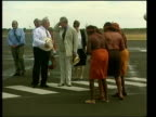 Alice Springs AUSTRALIA Alice Springs EXT Prince Charles Prince of Wales chatting to man as group of aboriginal women dancing in f/g CS Grub held by...