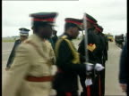 Prince Charles bEEN POOLSWAZILANDPrince Charles wearing garland of flowers along with officials past planeMS dittoMS police and...