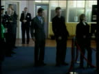 Fiftieth birthday ITN ENGLAND Sheffield EXT GV people lining reenacting dole queue scene from film 'The Full Monty' where characters dance to Donna...