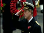 Prince Charles in naval dress uniform salutes and looks downcast during remembrance service Nov 01