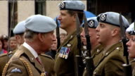 Prince Charles presents medals to 9th Regiment Army Air Corps and speech ENGLAND Yorkshire Boroughbridge EXT General views and close ups of Prince...