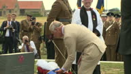Prince Charles Prince of Wales placing flower wreath down during Welsh National Service of Remembrance at the Welsh National Memorial Park to mark...