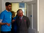 Prince Charles spends the afternoon at a National Citizen Service event CLEAN Shows interior shots Prince Charles walking into room shaking hands...