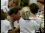 Prince Charles visit NEW MS Schoolchildren CMS Prince Charles talking to schoolchildren MS Person dressed as ram bowling to Prince on cricket pitch...