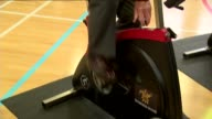 Prince Charles visit to Dumfries House Charles along in spin class / Charles using exercise bike in spin class / Charles along in spin class