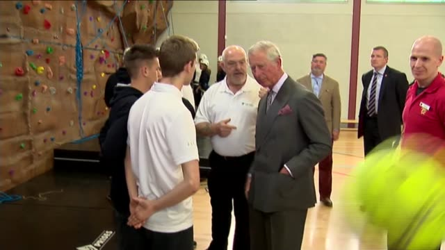 Prince Charles visit to Dumfries House Charles meeting others and chatting / Charles along / Charles watching people using climbing wall / Charles...