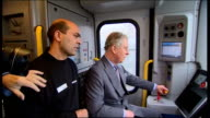 Prince Charles visits Bombardier factory in Derby Charles driving train SOT / round of applause as train stops SOT Charles receiving model train gift...