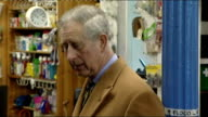 Prince Charles visits Cockermouth ENGLAND Cumbria Cockermouth EXT Prince of Wales from car and greeted and people taking photographs of the Prince on...