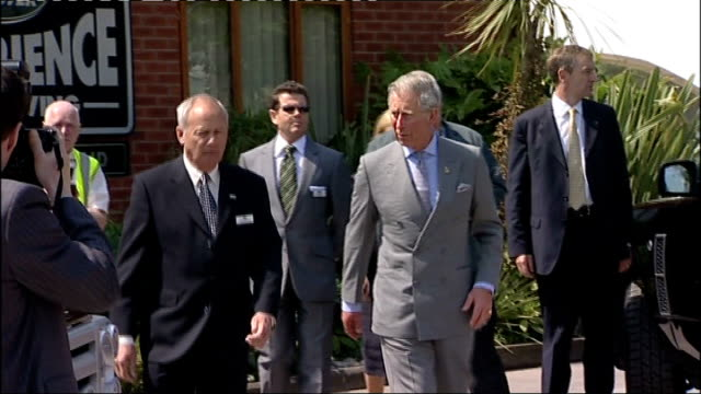 Prince Charles visits Land Rover factory and Selly Oak Hospital EXT Royal car arriving / Charles out of Range Rover then greeting unidentified man /...