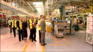 Prince Charles visits Land Rover factory and Selly Oak Hospital Charles along factory floor / Various of Charles along as talking to unidentified...