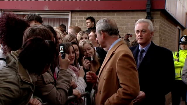Prince Charles visits Mereway Community College EXT Children waving from window / Prince Charles from school and meeting people during walkabout /...