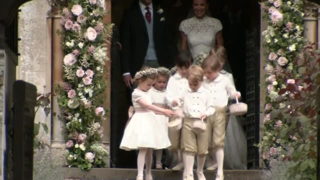 Prince George and Princess Charlotte have starring roles at Pippa Middleton's wedding Bridesmaids standing at entrance to the church Guests arriving...