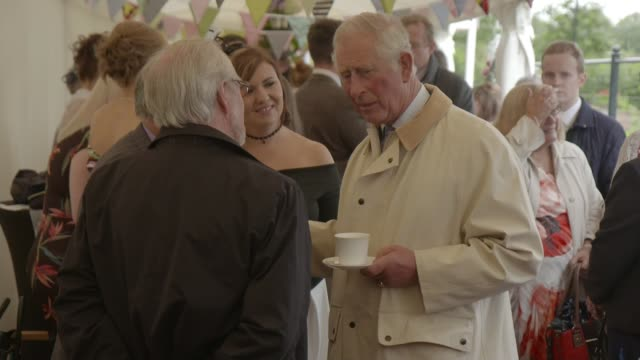 East Ayrshire Dumfries House INT Prince Charles Prince of Wales chatting with guests in marquee
